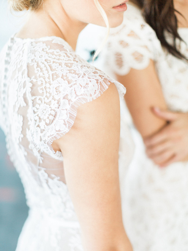 lace wedding dress detail - photo by Heidrich Photography http://ruffledblog.com/monochrome-bridal-inspiration