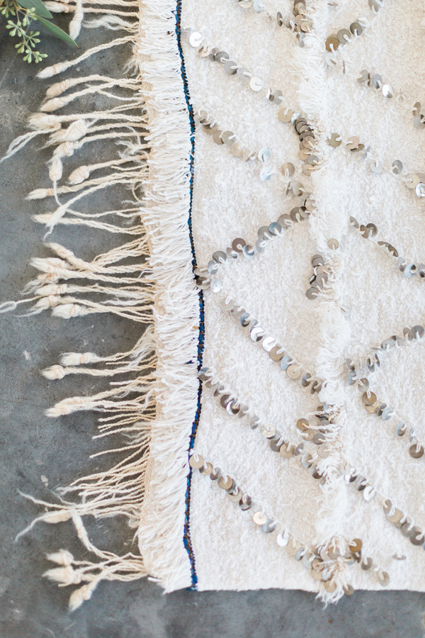Moroccan wedding blanket - photo by Heidrich Photography http://ruffledblog.com/monochrome-bridal-inspiration