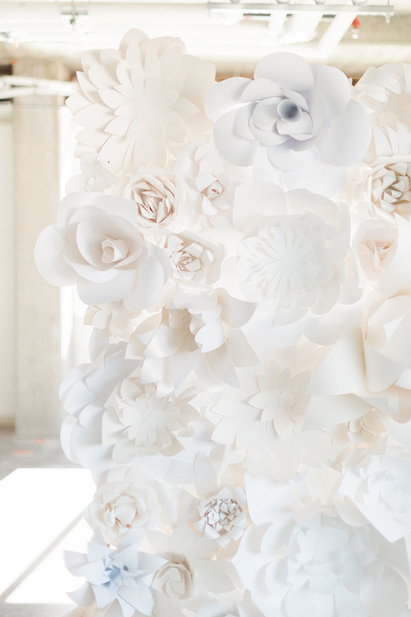 paper flower backdrop - photo by Heidrich Photography http://ruffledblog.com/monochrome-bridal-inspiration