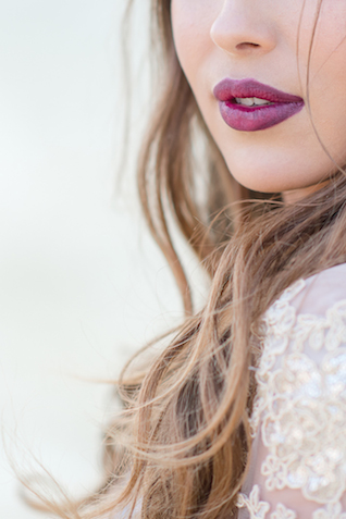 Marsala lip color | Lightburst Photography | see more on: http://burnettsboards.com/2016/01/earthy-sophisticated-desert-wedding/