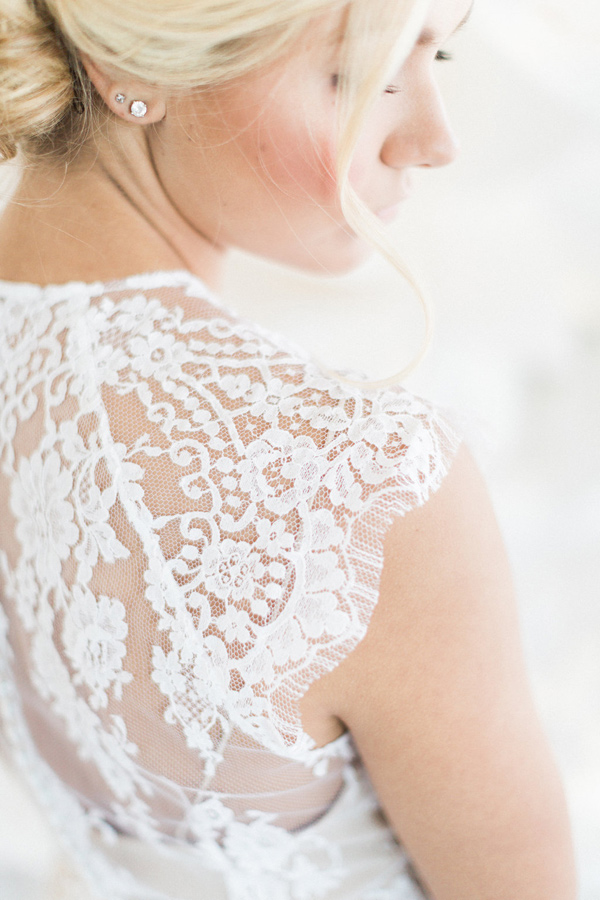 lace wedding dress cap sleeve - photo by Heidrich Photography http://ruffledblog.com/monochrome-bridal-inspiration