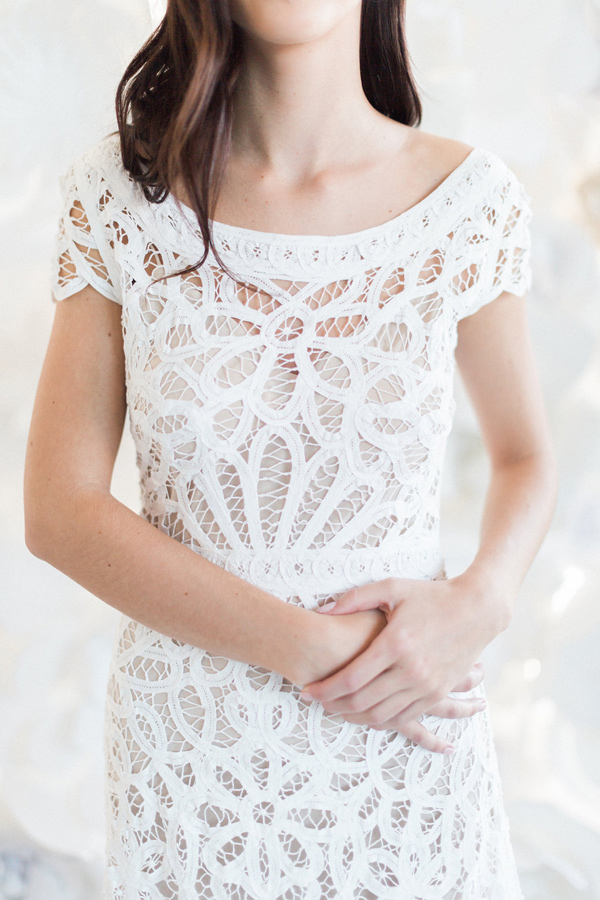 cutout lace wedding dress - photo by Heidrich Photography http://ruffledblog.com/monochrome-bridal-inspiration