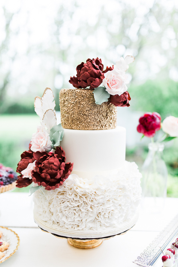 gold and burgundy wedding cake - photo by Rosenlee Photography http://ruffledblog.com/best-of-2015-wedding-cakes