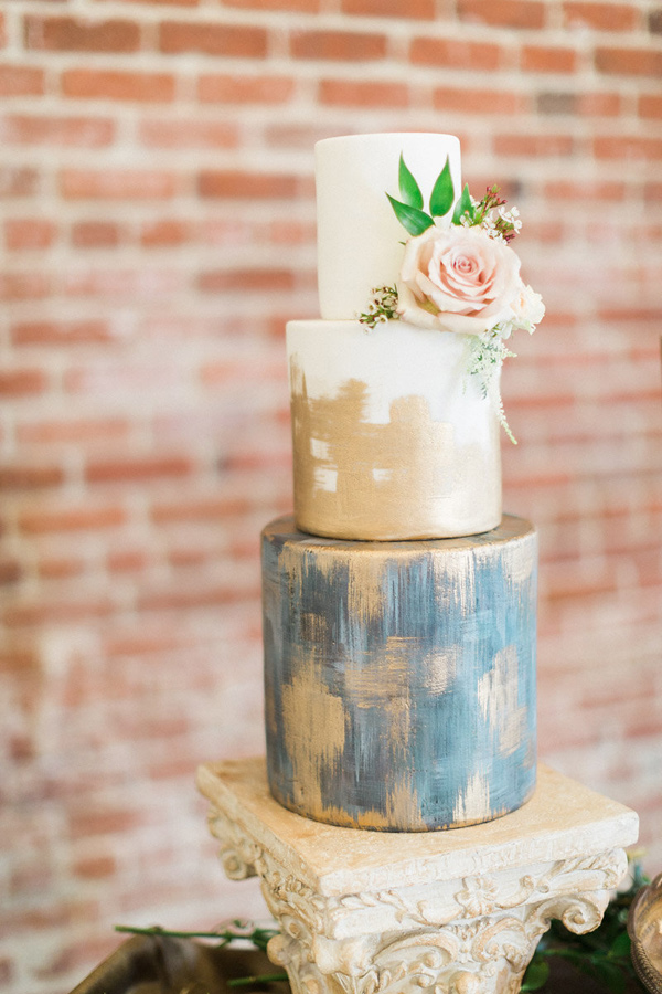 gold painted wedding cake - photo by Kristina Adams Photography http://ruffledblog.com/best-of-2015-wedding-cakes