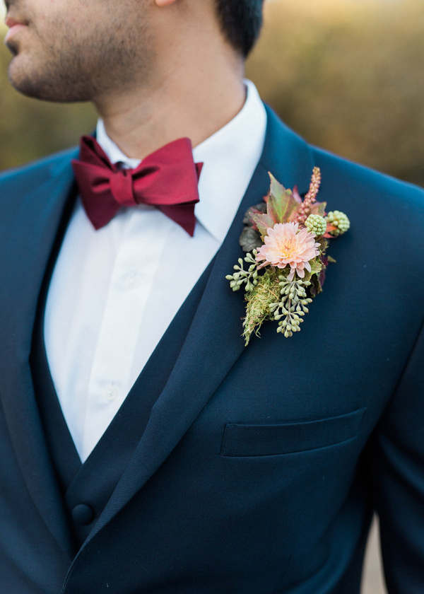 grooms boutonniere - photo by Rebecca Masters Photography http://ruffledblog.com/mountain-vineyard-wedding-inspiration