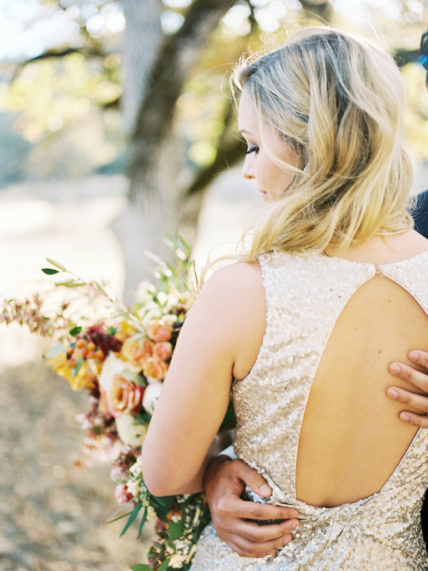 open back sequin wedding dress - photo by Rebecca Masters Photography http://ruffledblog.com/mountain-vineyard-wedding-inspiration