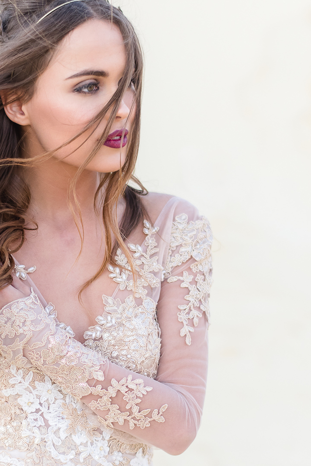 Embellished long-sleeved wedding dress | Lightburst Photography | see more on: http://burnettsboards.com/2016/01/earthy-sophisticated-desert-wedding/