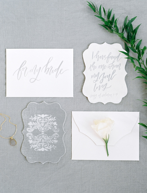 grey and white wedding invitations - photo by Ben Q Photography http://ruffledblog.com/easy-romantic-wedding-inspiration