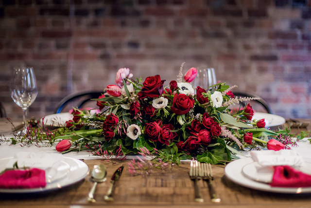 Red floral centerpiece | Kelsea K Photography | see more on: http://burnettsboards.com/2016/02/industrial-romance/