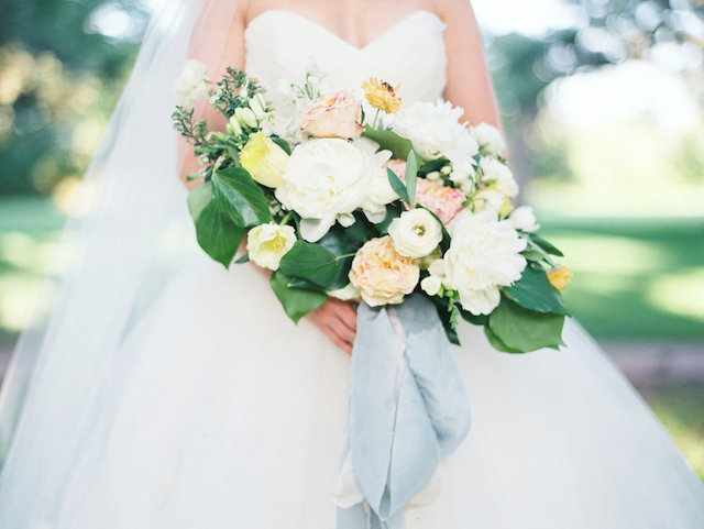 Romantic bridal bouquet with thick ribbon | Courtney Leigh Photography | see more on: http://burnettsboards.com/2016/02/romantic-outdoor-southern-mansion-wedding/