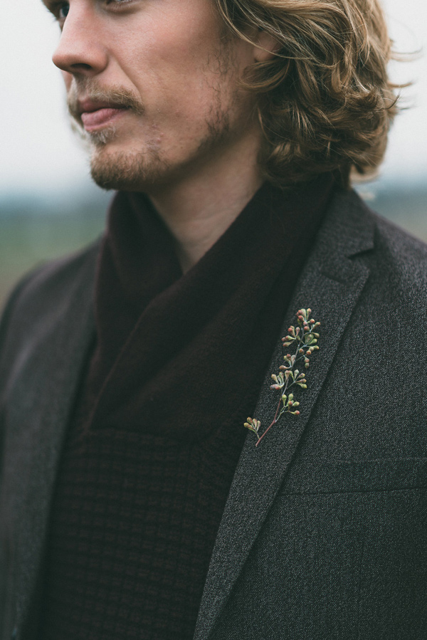 simple boutonniere - photo by LV Imagery http://ruffledblog.com/nordic-inspired-woodland-wedding