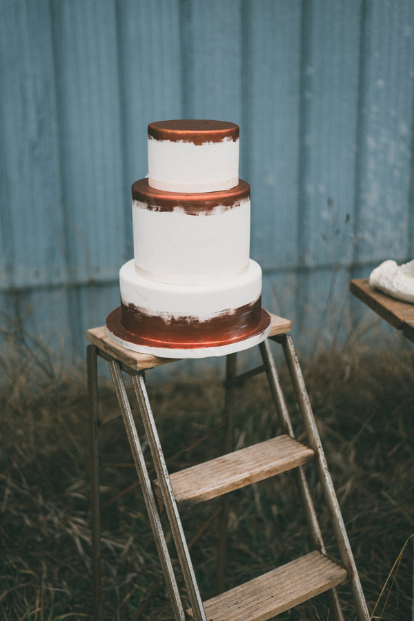 painted wedding cake - photo by LV Imagery http://ruffledblog.com/nordic-inspired-woodland-wedding