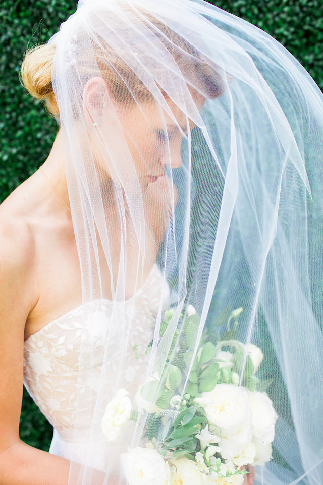 Unique bridal veil shot | Mandy Forlenza Sticos and Maria Cascio Photography | see more on: http://burnettsboards.com/2016/02/airy-paper-factory-hotel-bridals/