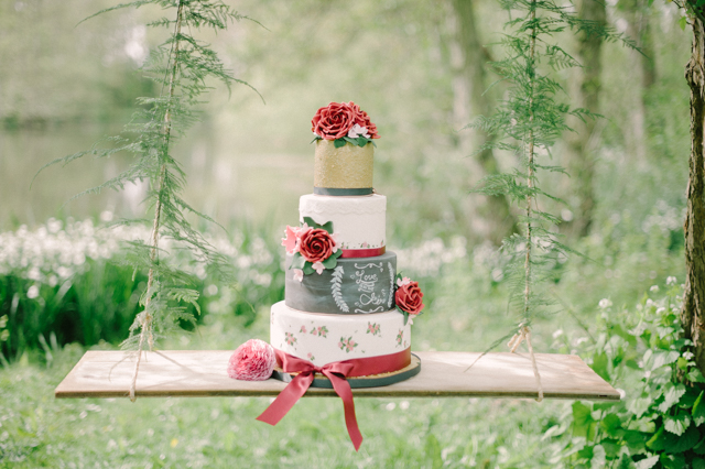 Whimsical red and white wedding cake with chalkboard layer | Plenty To Declare Photography | see more on: http://burnettsboards.com/2016/02/whimsical-marsala-celebration/