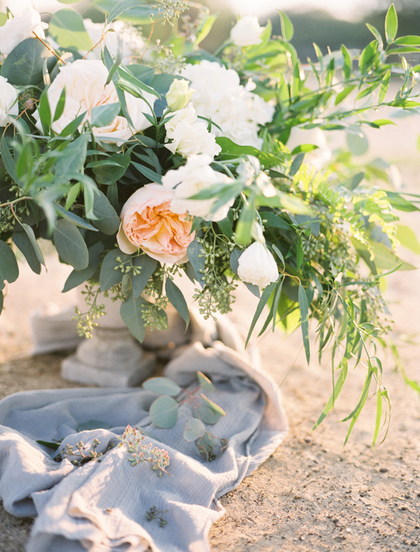 peach floral arrangement - photo by Ben Q Photography http://ruffledblog.com/easy-romantic-wedding-inspiration