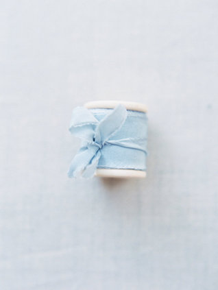 Powder blue spool of ribbon | Courtney Leigh Photography | see more on: http://burnettsboards.com/2016/02/romantic-outdoor-southern-mansion-wedding/