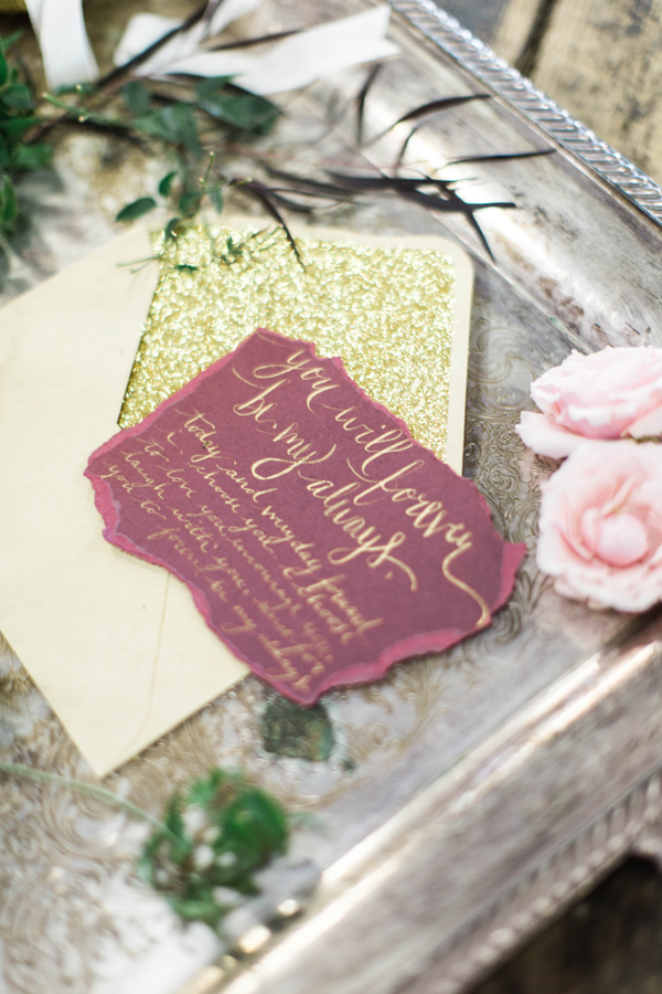 burgundy and gold stationery - photo by A.Fogarty Photography http://ruffledblog.com/romantic-bridal-boudoir-inspiration