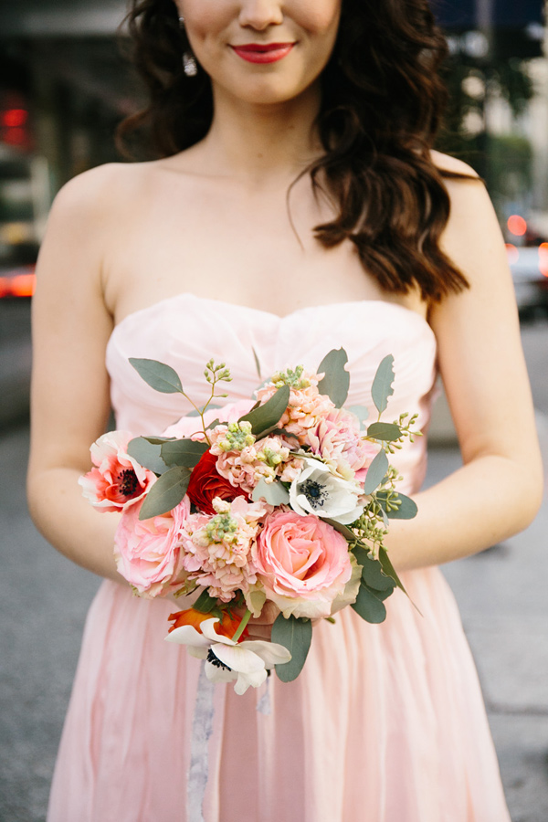 pink bouquet with anemone - photo by La Rousse Photo http://ruffledblog.com/schoolhouse-charm-wedding-inspiration
