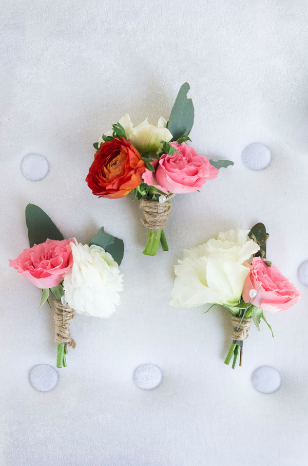 pink boutonnieres - photo by Peterson Design and Photography http://ruffledblog.com/schoolhouse-charm-wedding-inspiration