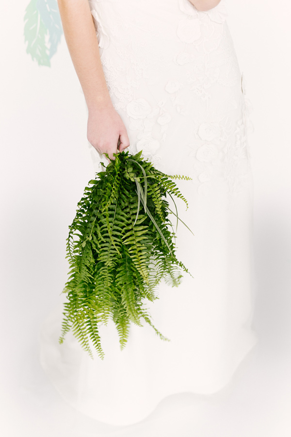 fern bouquet - photo by Emily Chidester Photography DIY by Studio Cultivate for Ruffled http://ruffledblog.com/diy-paper-feather-backdrop