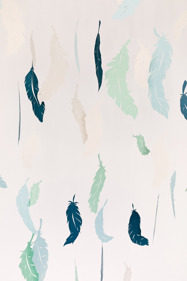 paper feather backdrop - photo by Emily Chidester Photography DIY by Studio Cultivate for Ruffled http://ruffledblog.com/diy-paper-feather-backdrop