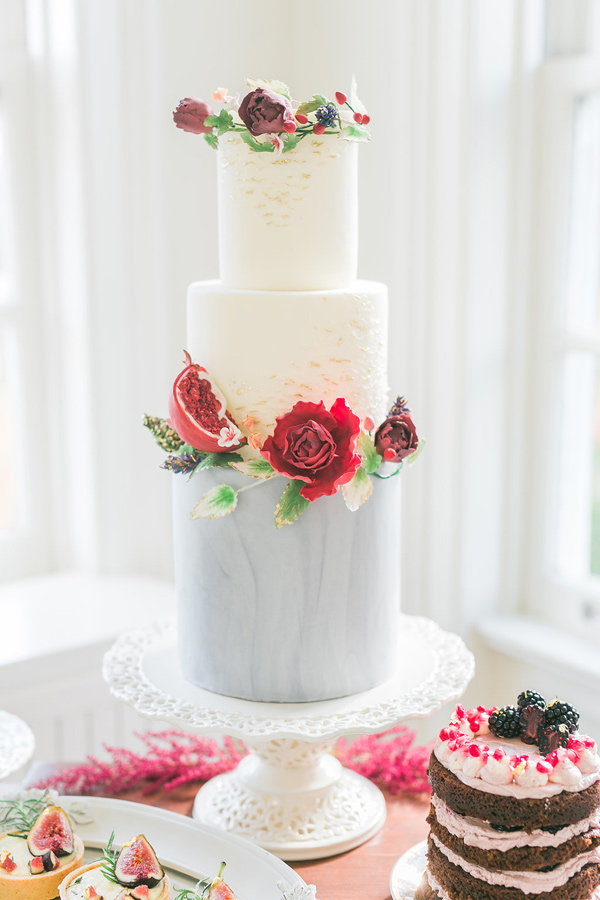 modern wedding cake with flowers - photo by Rhythm Photography http://ruffledblog.com/historic-estate-engagement-inspiration