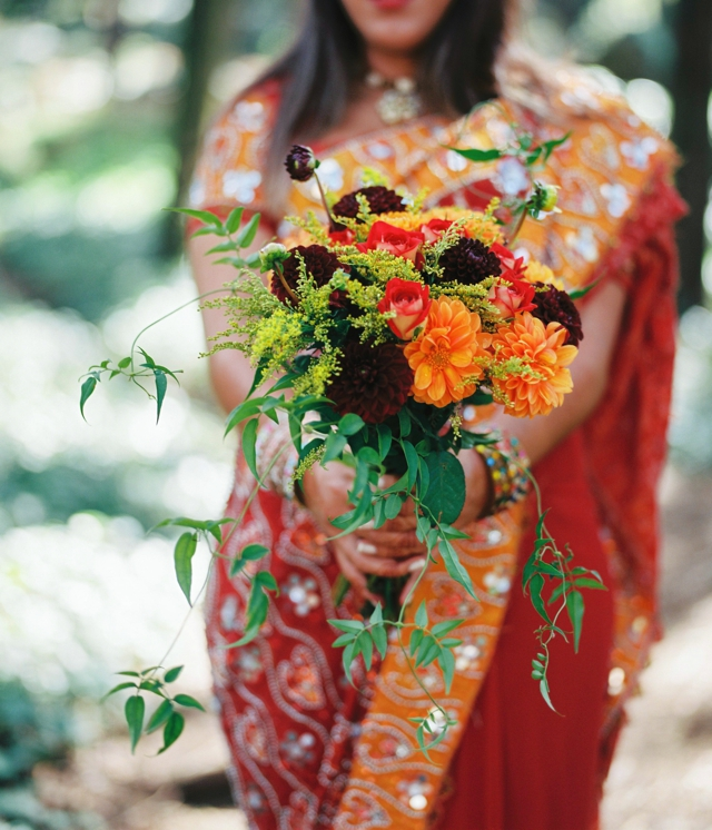 Colorful bridal bouquet in orange, plum, and green | 5 Photography