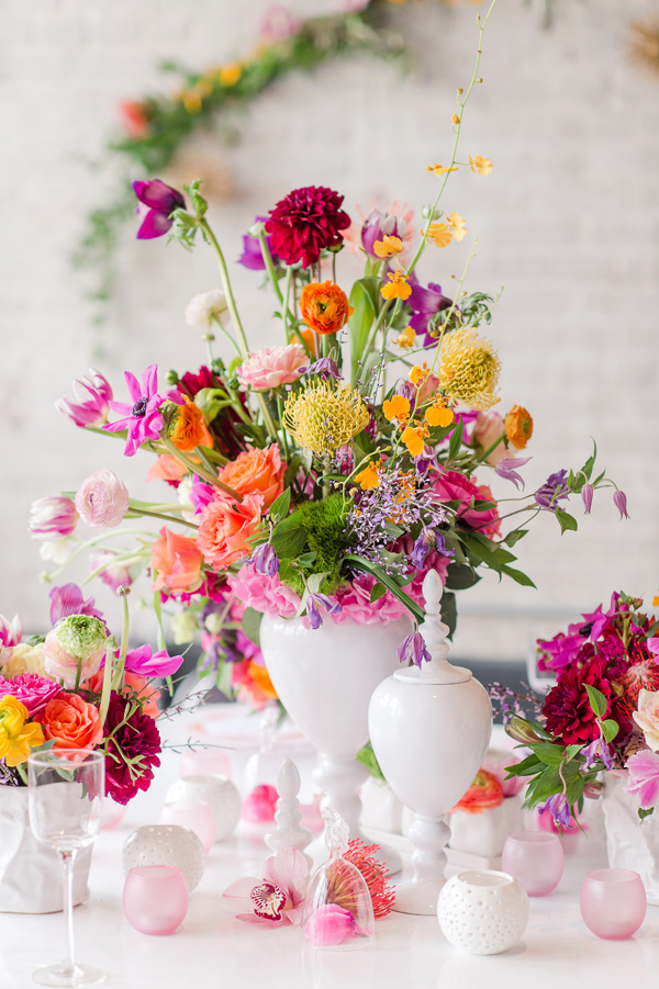colorful centerpiece - photo by Tina Jay Photography http://ruffledblog.com/bright-and-modern-vow-renewal
