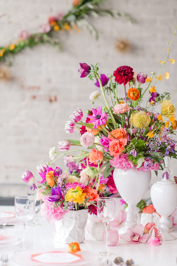 bright wedding flowers - photo by Tina Jay Photography http://ruffledblog.com/bright-and-modern-vow-renewal
