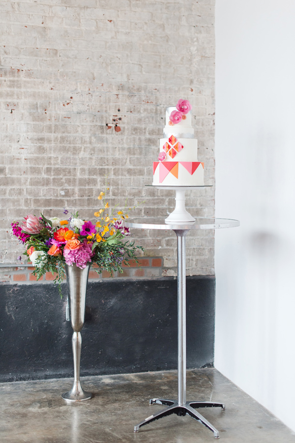cake display - photo by Tina Jay Photography http://ruffledblog.com/bright-and-modern-vow-renewal