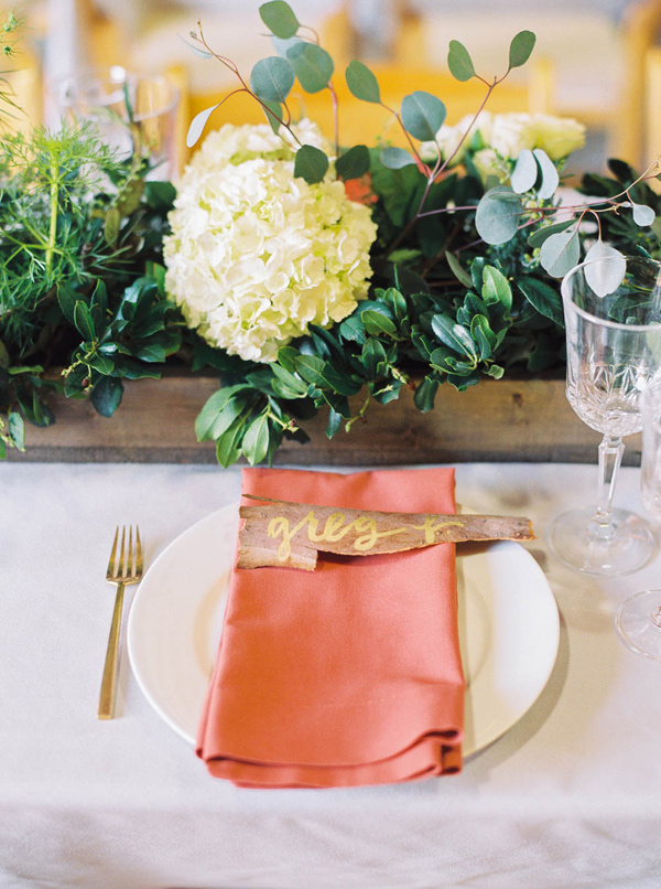 coral place setting - photo by Danielle Poff http://ruffledblog.com/arroyo-grande-barn-wedding