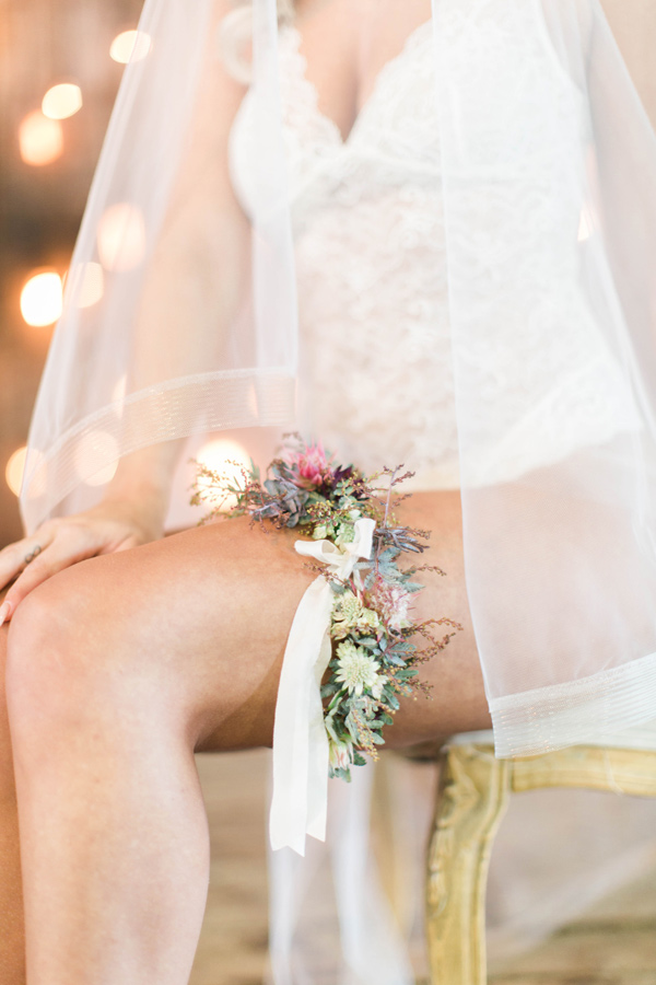 floral garter - photo by A.Fogarty Photography http://ruffledblog.com/romantic-bridal-boudoir-inspiration