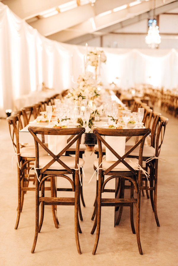 reception chairs - photo by Steve Stanton Photography http://ruffledblog.com/greek-inspired-colorado-ranch-wedding