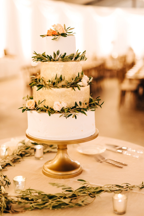 wedding cake with olive branches - photo by Steve Stanton Photography http://ruffledblog.com/greek-inspired-colorado-ranch-wedding