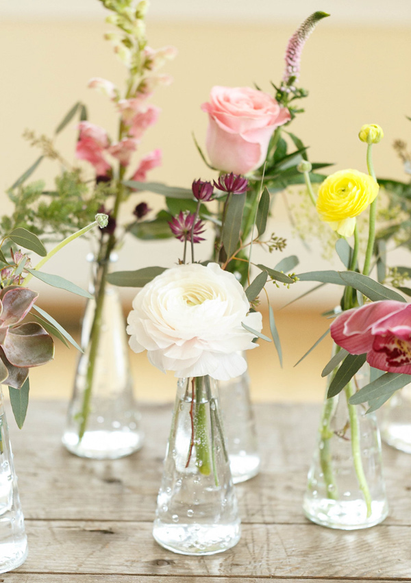 bud vase centerpieces - photo by Virginia Ashley Photography http://ruffledblog.com/mermaid-bride-wedding-inspiration