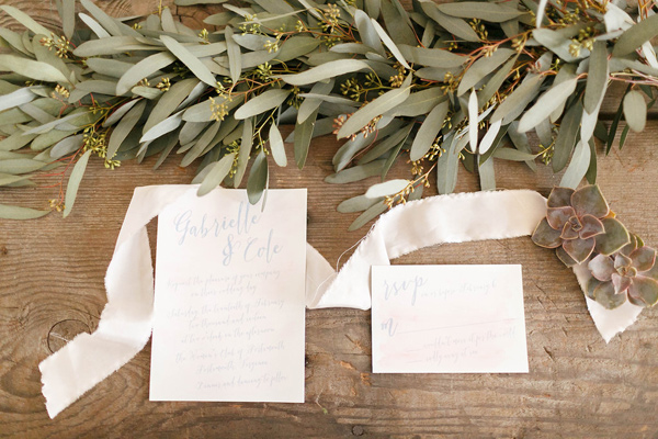 pale pink wedding invitations - photo by Virginia Ashley Photography http://ruffledblog.com/mermaid-bride-wedding-inspiration