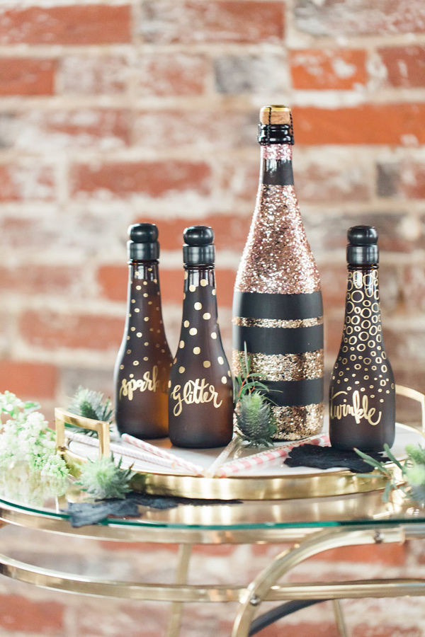 glittered bottles - photo by Jessica Cooper Photography http://ruffledblog.com/sweet-caroline-bridal-collection