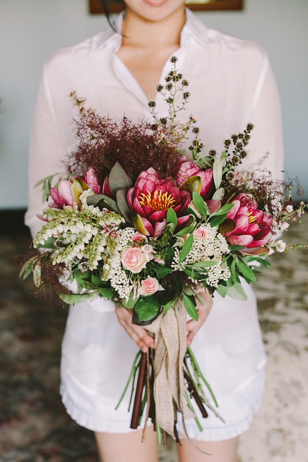 bridesmaid bouquet with protea - photo by Lara Hotz Photography http://ruffledblog.com/botanical-australian-barn-wedding