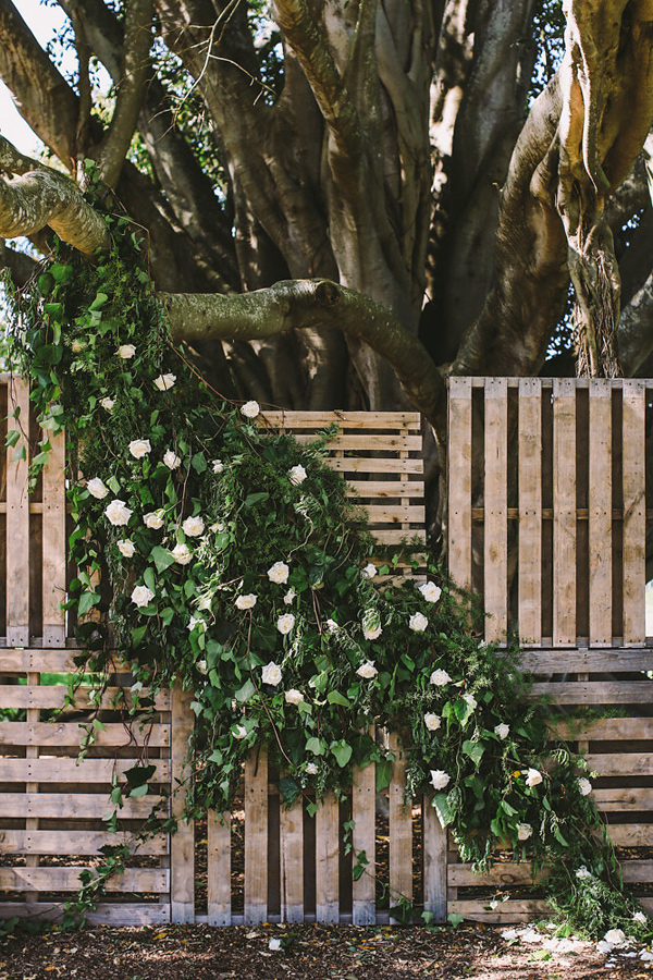 ceremony backdrop - photo by Lara Hotz Photography http://ruffledblog.com/botanical-australian-barn-wedding