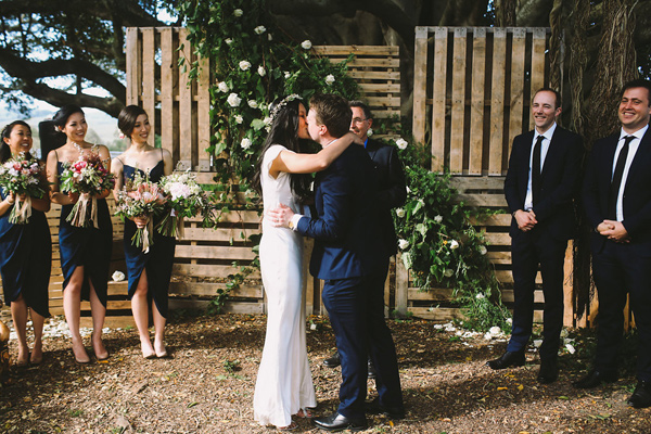 ceremony kiss - photo by Lara Hotz Photography http://ruffledblog.com/botanical-australian-barn-wedding