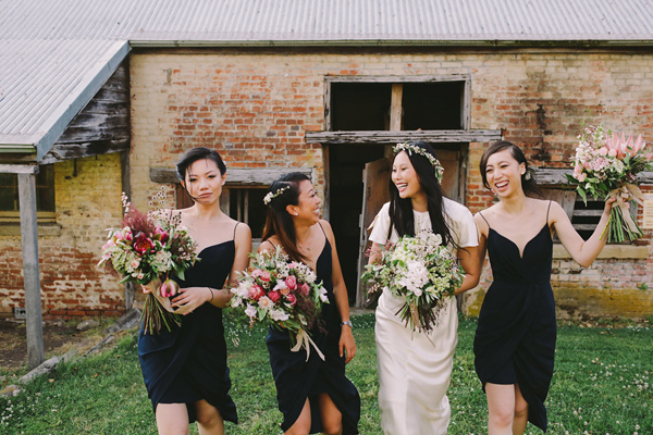 black bridesmaid dresses - photo by Lara Hotz Photography http://ruffledblog.com/botanical-australian-barn-wedding