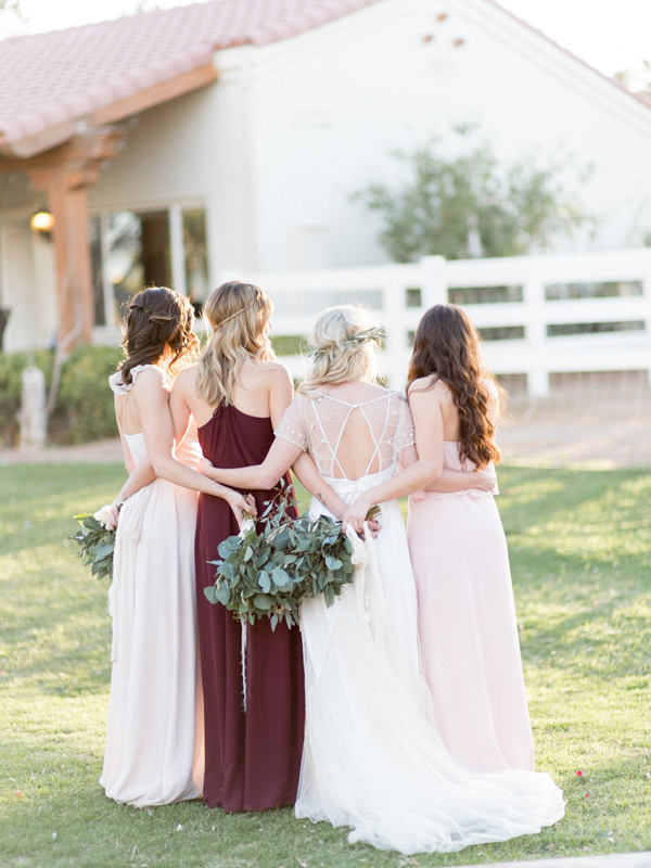 bridesmaids in blush pink and burgundy - photo by Kristen Joy Photography http://ruffledblog.com/boho-ranch-wedding-inspiration