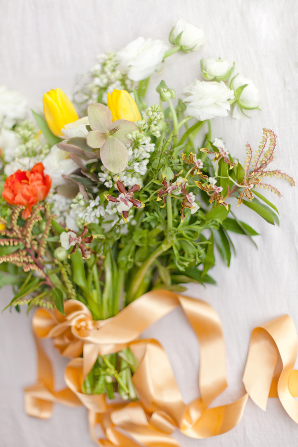 yellow and orange bouquet - photo by Corette Faux Photography http://ruffledblog.com/eleventh-century-abbey-wedding