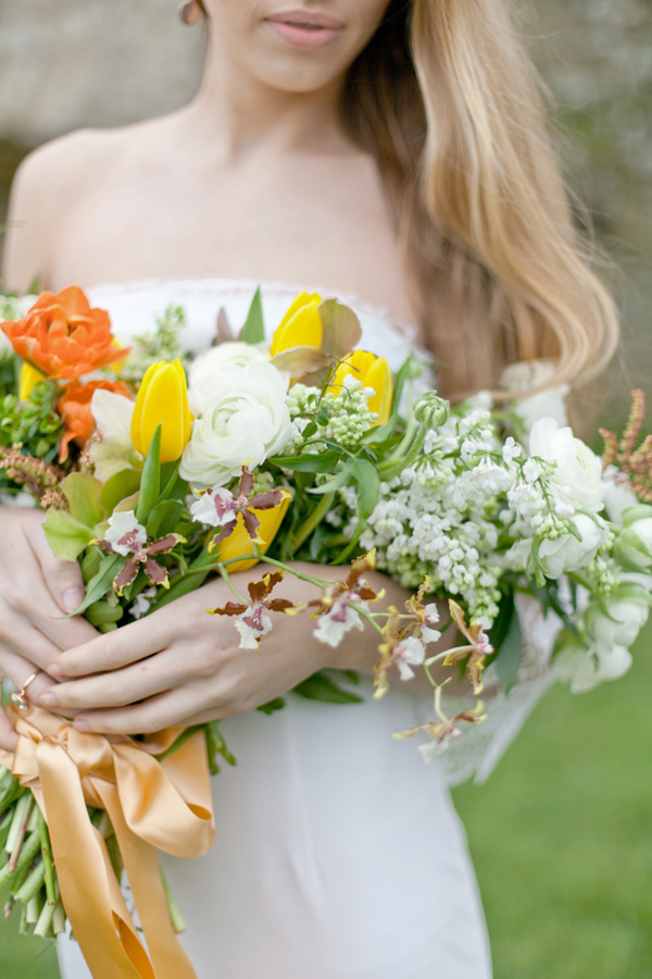 yellow tulip bouquet - photo by Corette Faux Photography http://ruffledblog.com/eleventh-century-abbey-wedding