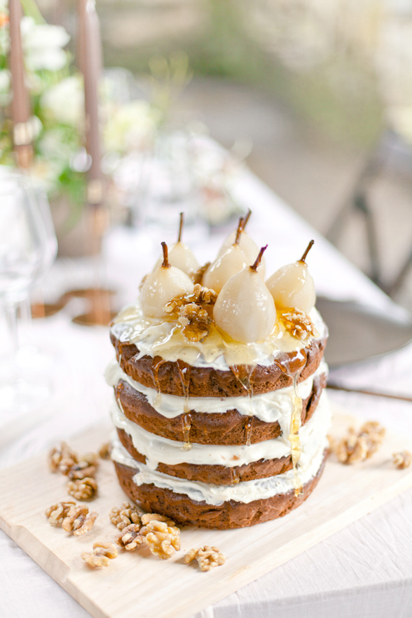 wedding cake topped with pears - photo by Corette Faux Photography http://ruffledblog.com/eleventh-century-abbey-wedding