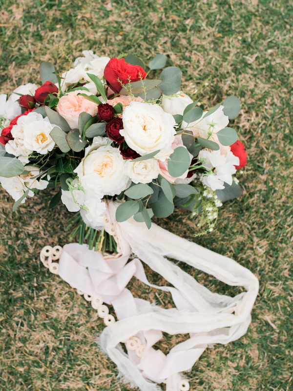 ivory bouquet with red flowers - photo by Kristen Joy Photography http://ruffledblog.com/boho-ranch-wedding-inspiration