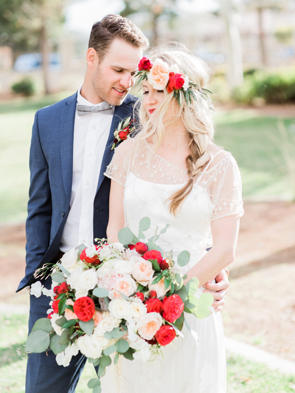 red and pink wedding flowers - photo by Kristen Joy Photography http://ruffledblog.com/boho-ranch-wedding-inspiration
