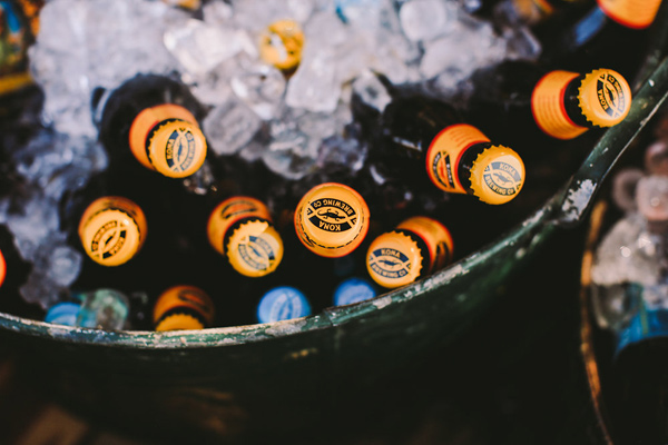 beer table - photo by Lara Hotz Photography http://ruffledblog.com/botanical-australian-barn-wedding