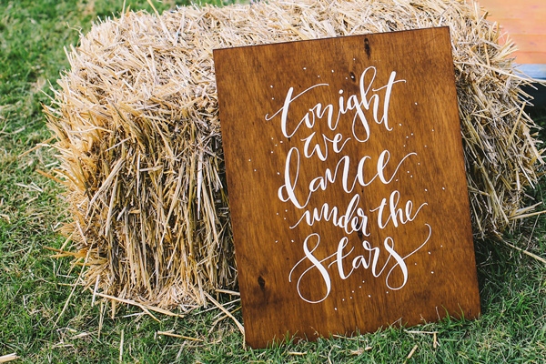 dancing sign - photo by Lara Hotz Photography http://ruffledblog.com/botanical-australian-barn-wedding