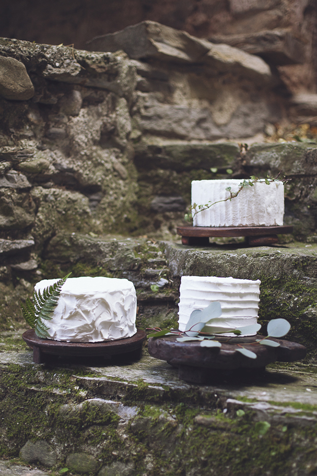 Cake display with foliage and wooden stands | Photography by Tiziana Gallo | Burnett's Boards